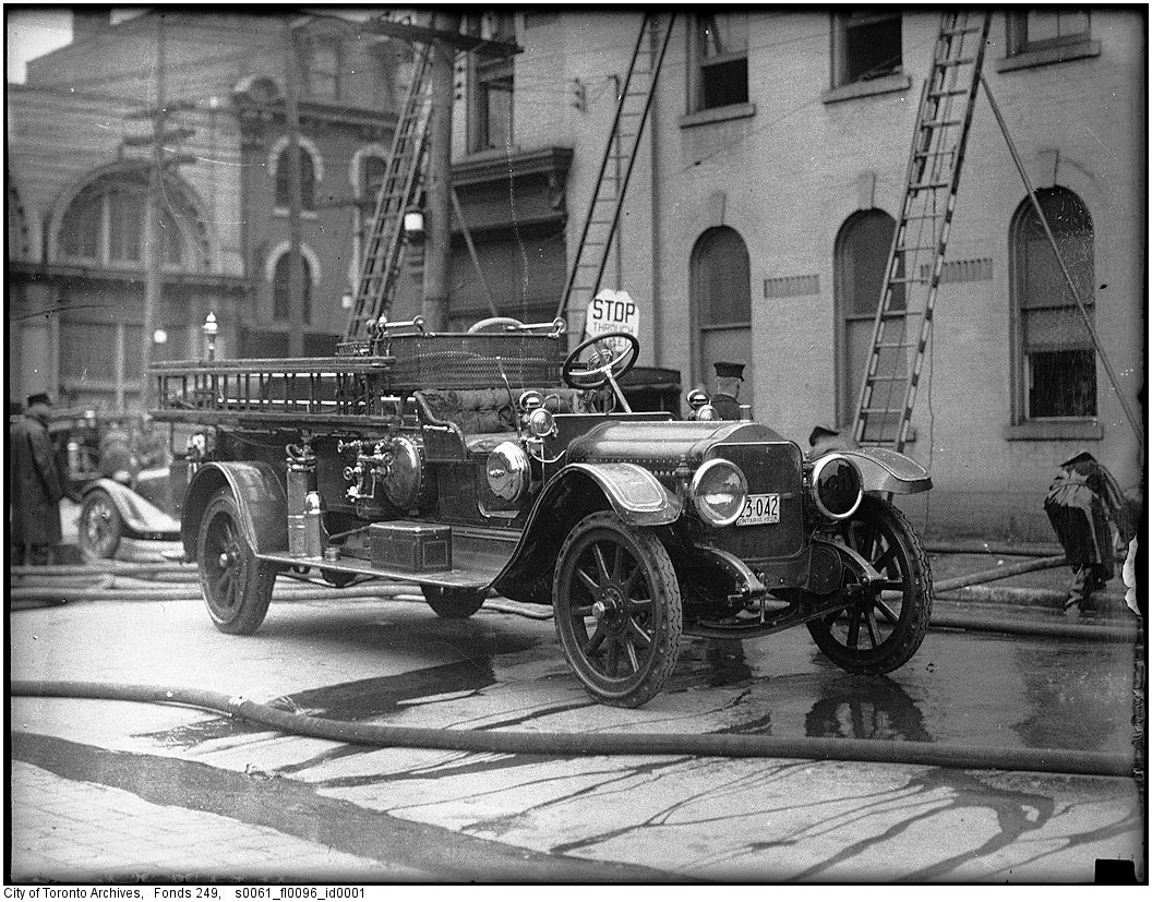 1927-1940 - White hose and combination truck, possibly No. 6, at 2nd-alarm fire, Jarvis and Richmond streets