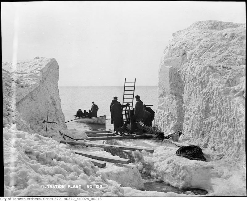 1911 - Cleared path through snow bank to open lake at Island Filtration Plant construction site