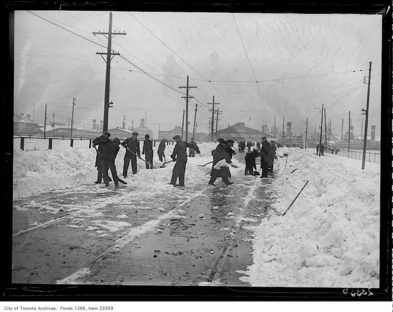 1931 - Snow clearing, men on lower Bay Street