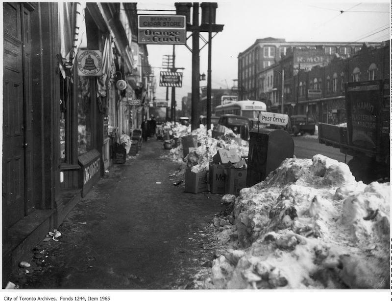 1938 - Garbage and snow on sidewalk