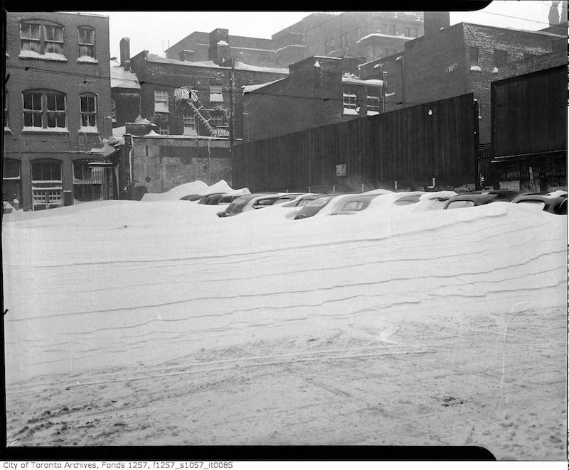 1944 - Dec 11 - Unidentified parking lot after a snow storm