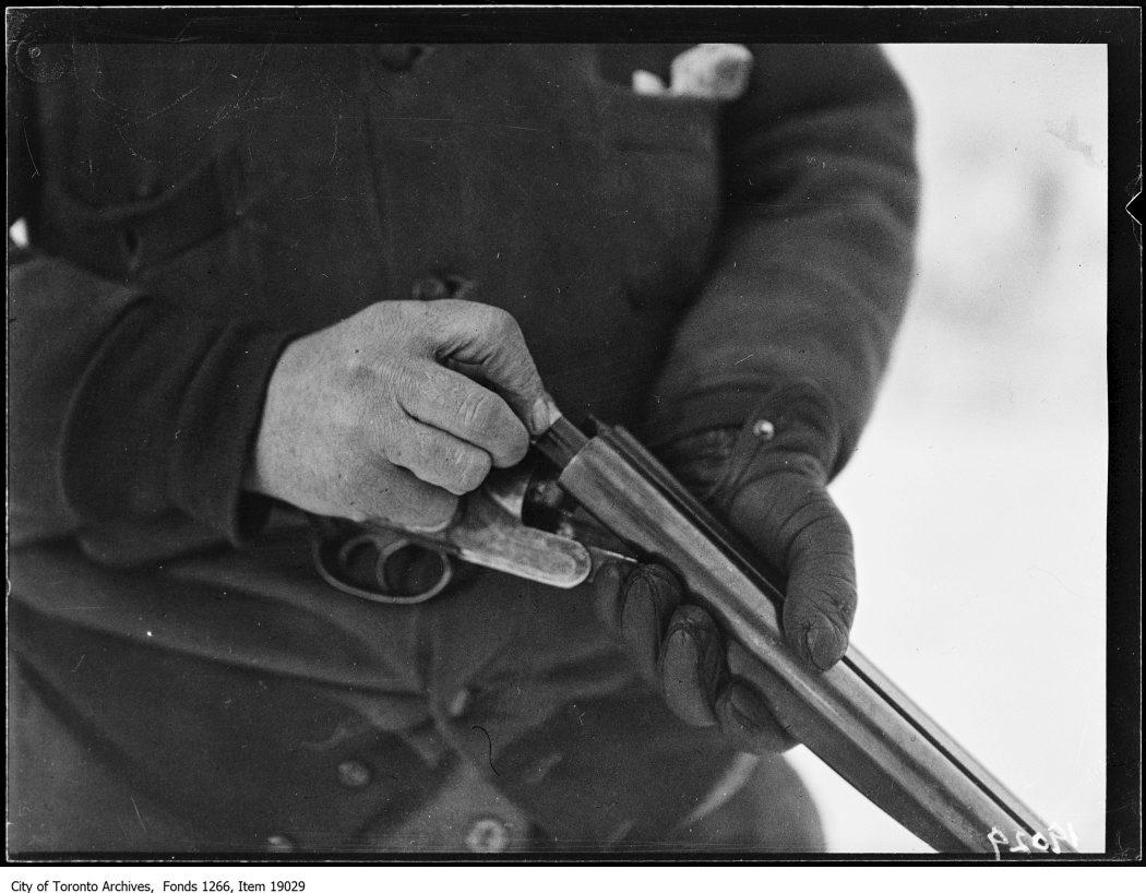 1930 - January 18 - Clarkson rabbit hunt, hunter loading gun