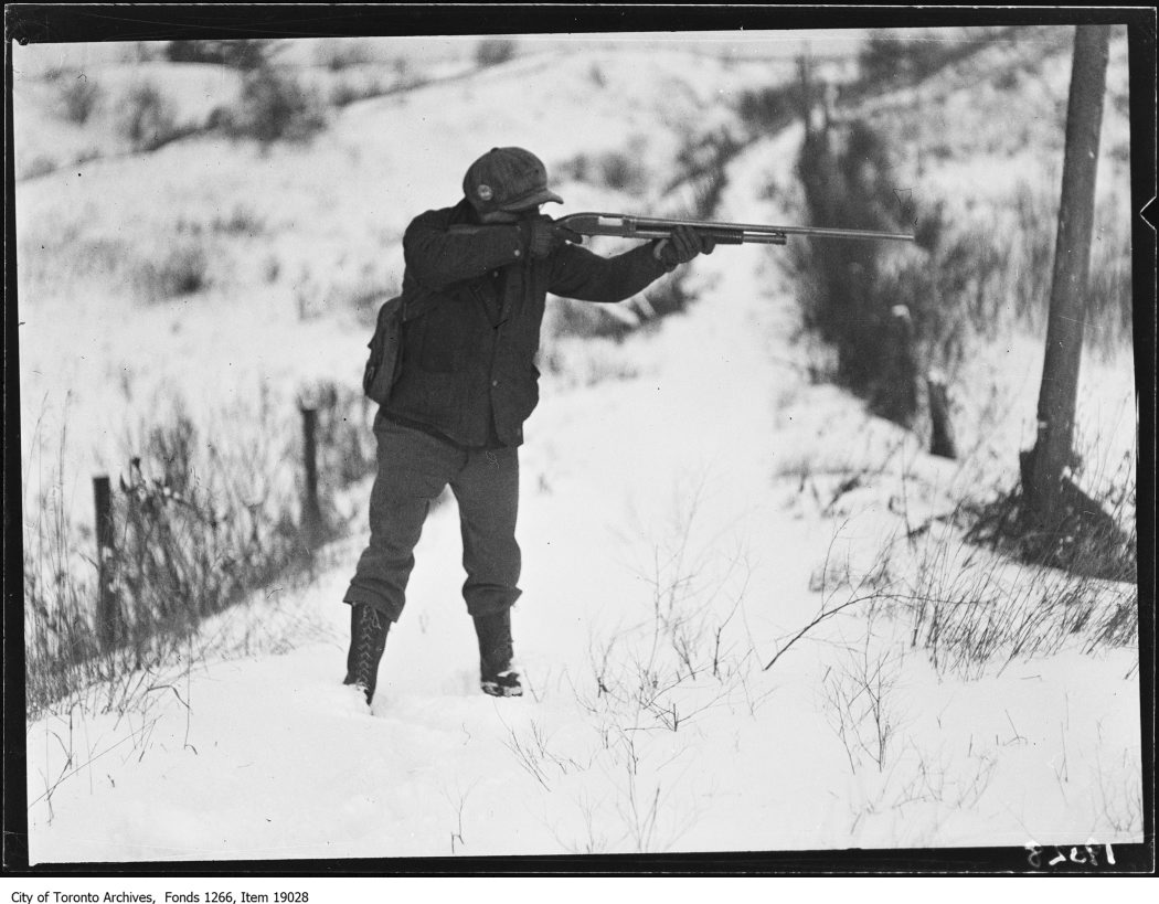 1930 - January 18th - Clarkson rabbit hunt, hunter pointing gun