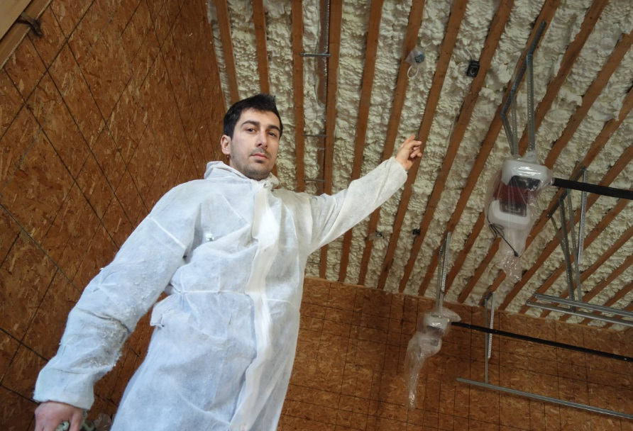 George proudly shows garage ceiling spray foam