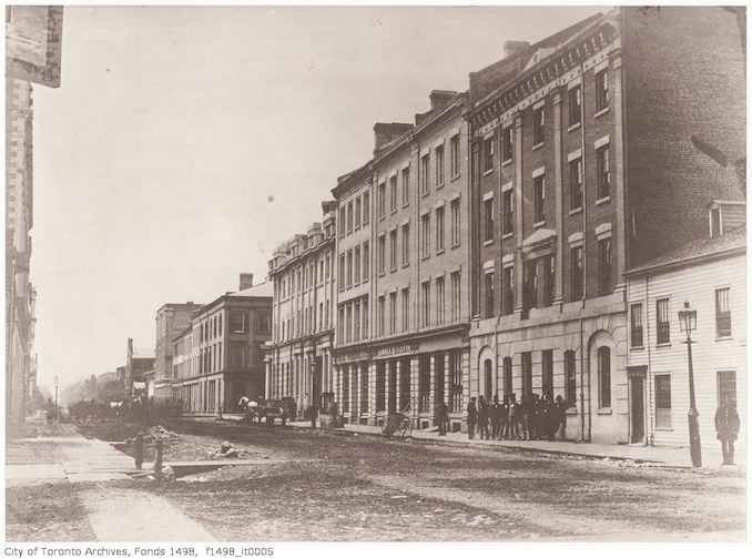 1856 - Wellington Street East north-side between Church and Yonge streets, showing the Wellington Hotel