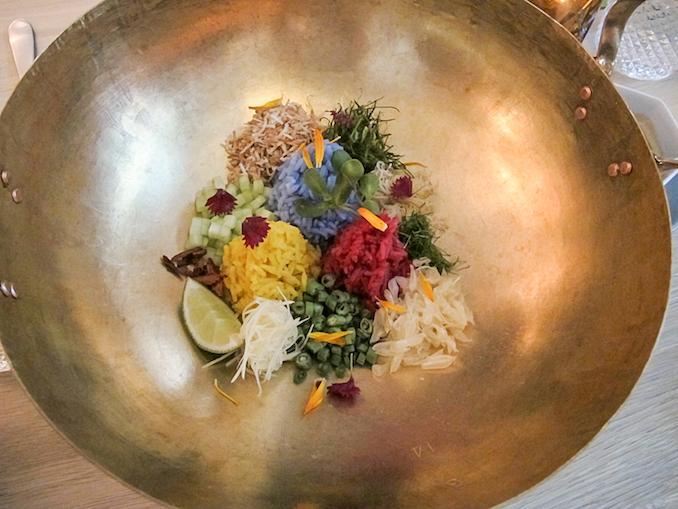 Pomelo Rice Bowl. A complex rice dish containing naturally coloured jasmine rice. Flavours ranging from lemongrass, Thai spice, and a fresh acidity from the individually picked pomelo grains - kiin Toronto
