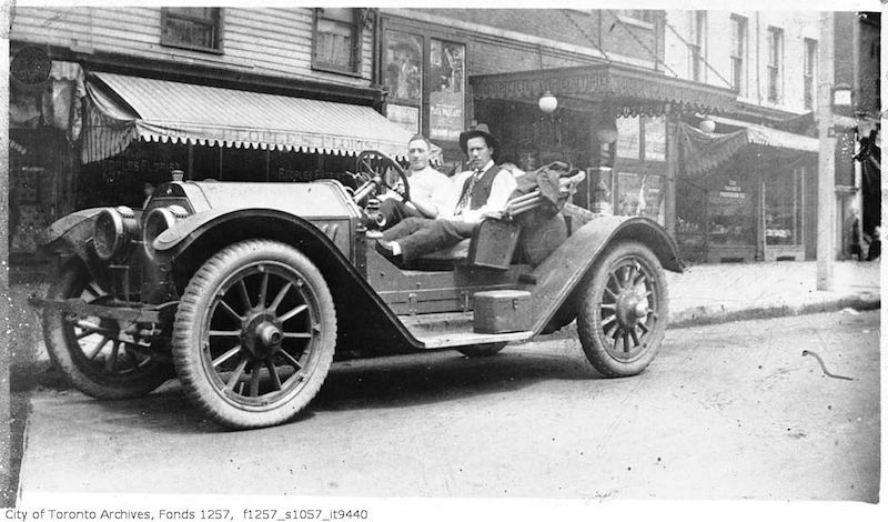 1912 - Lou Turofsky, in his first car, near the original studio, 322 1:2 Queen Street West