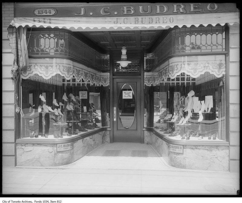 1913 - Window display of ladies and gentlemen's shoes, with leaded upper windows and Humphrey arc gas light, J. C. Buidreo, 1344 Queen Street West