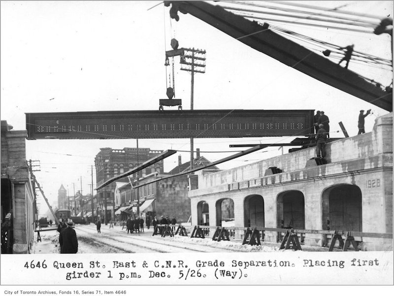 1926 - Dec 5 - Queen St East and Canadian National Railway grade separation, placing first girder, 1 p.jpg
