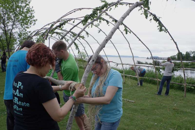 A group of volunteers work on the bracing to reinforce the 13 main arcs on the Rites of Passage teaching lodge that was set up on June 19 at the Thunder Bay waterfront for National Aboriginal Day and Canada Day - Rick Garrick - National Aboriginal Day