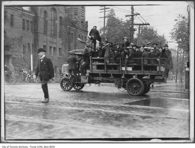 1919 - Truck carries passengers during streetcar strike, Spadina Avenue and College Street