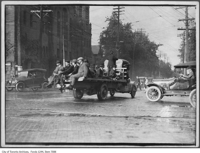1919 - Truck carrying passengers during streetcar strike, northeast corner of College Street and Spadina Avenue