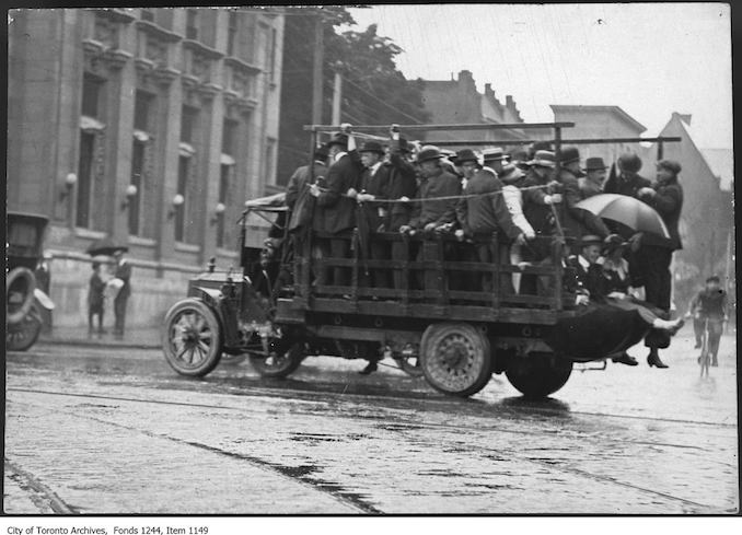 1920 - Truck used as transportation during streetcar strike, Spadina Avenue and College Street