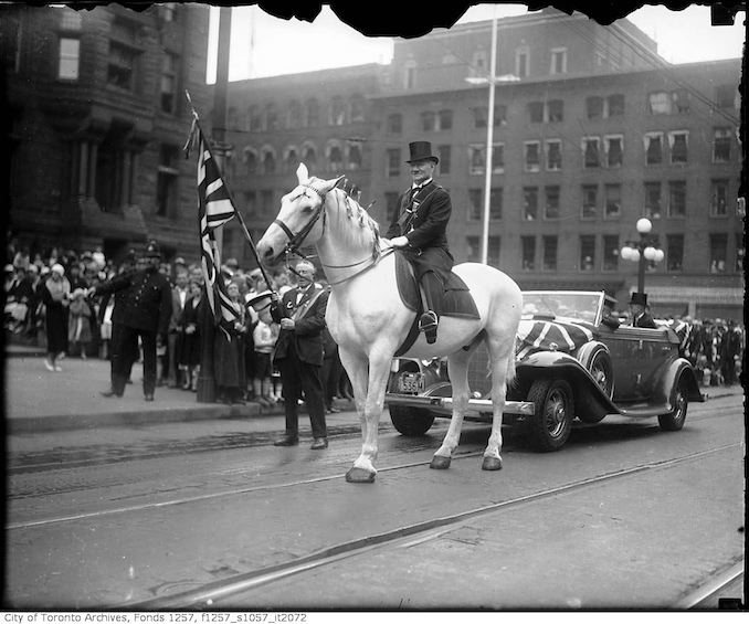 1932 - July 12 - Marshall W. H. Harper on horse in Orange Parade, Queen Street West