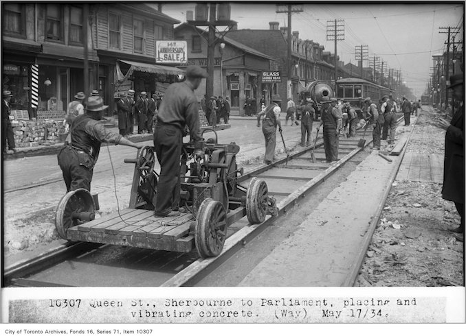1934 - May 17 - Queen St, Sherbourne to Parliament, placing and vibrating concrete,