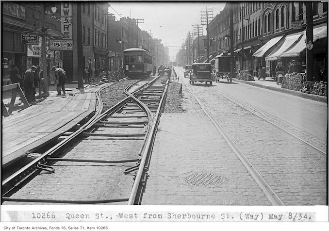 1934 - May 8 - Queen St, west, from Sherbourne St