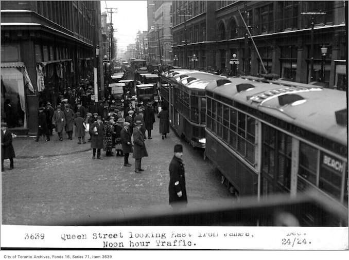 1924 - Dec 24 - Vintage Queen Street, looking east, from James, noon hour traffic