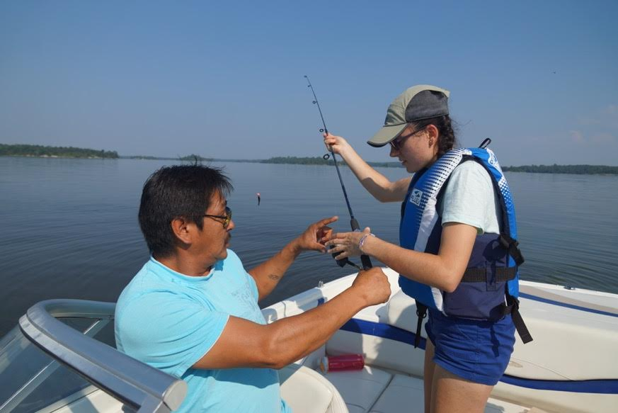 Teach for Canada teacher Laura Muntean, from Toronto, caught a fish during the Teach for Canada community visit to Big Grassy River First Nation in late July.