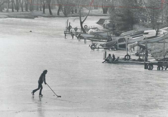 1973 - Metro's biggest hockey rink is at Michael Coyle's disposal as he skates by himself with a hockey stick and puck in the middle of the lagoon off Algonquin Island