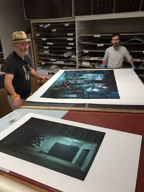 Checking final prints.
