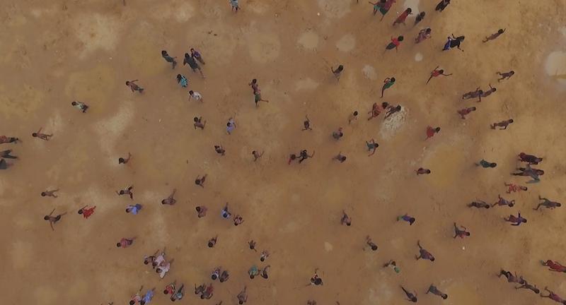 Children running in Human Flow doc. Kutupalong refugee camp in Bangladesh. - Get Woke