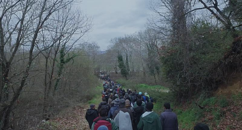 Scene from Human Flow doc, refugees walking near Idomeni Camp, Greece.