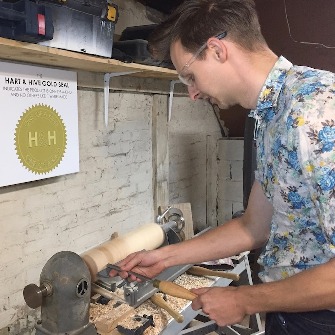 Here Thomas can be seen turning some maple legs on the lathe in his workshop. The wood was reclaimed from shipping pallets and are part of a chair he is working on.