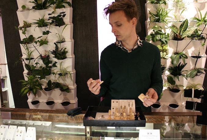 Surrounding himself with plant life is always important to Thomas and his showroom boasts two living walls (a product he also sells) Here, designer Thomas Hart, is seen inspecting some one-of-a-kind engagement rings designed in Toronto by Chancellor Jewels.