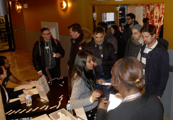 guests entering and donating at the door to HackerNest in Toronto