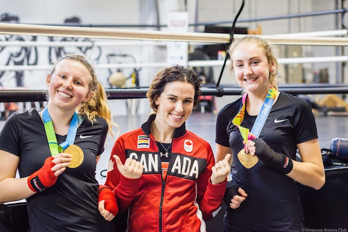 Mandy Bujold -  Only female boxer in history to win 2 Pan American Games titles. Mandy also represented Canada at 51kg in 2016 Rio Olympic Games. [Photo Courtesy of Virgil Barrow Photography | (left to right) Maya Canham, Mandy Bujold, Julia Switzer). Photo taken from the Exclusive Girls Teens Boxing Program -- Kingsway Boxing Club in Toronto. Mandy frequently invests back into the sport by mentoring youth as one of Canada's most accomplished ambassadors of boxing]