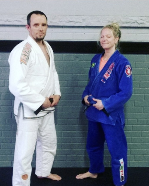 Dawn receiving her blue belt in Brazilian Jiu-Jitsu (eyes closed and all!)