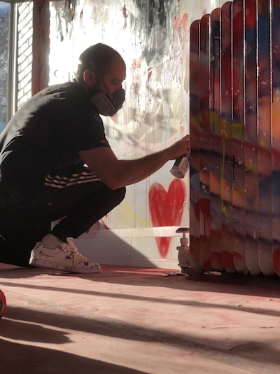 Anthony Ricciardi Paiting a Mural
