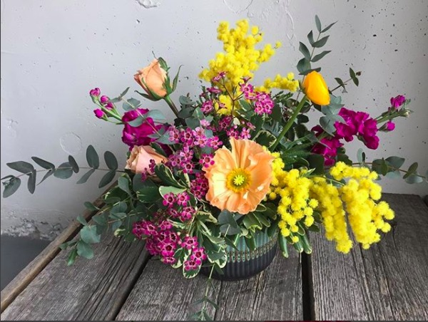 Yellow additions in a floral arrangement always make for a bright afternoon