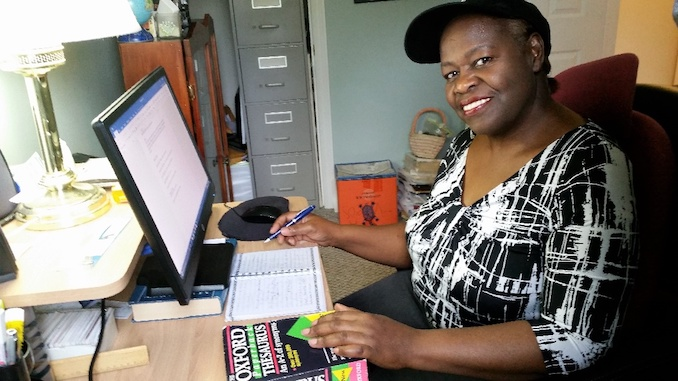 Yvonne Blackwood - Sitting at my desk in my office writing a story. I like to write my thoughts with a pen first, then I type them.