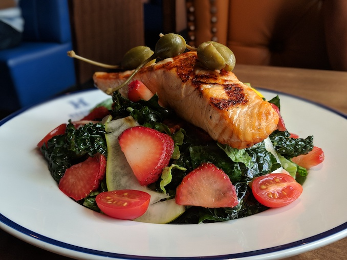 Salmon & Strawberry Salad: crisp romaine, emerald kale, pear, candied pecans, caperberries, champagne vinaigrette