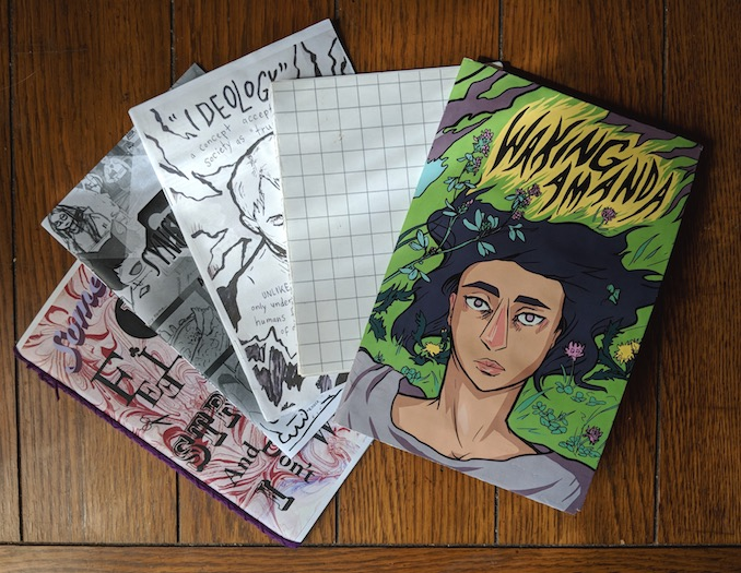 """A selection of zines and anthologies I have worked on and organized. To the far right is the first chapter of my current project, a graphic novel called """"Waking Amanda""""."""