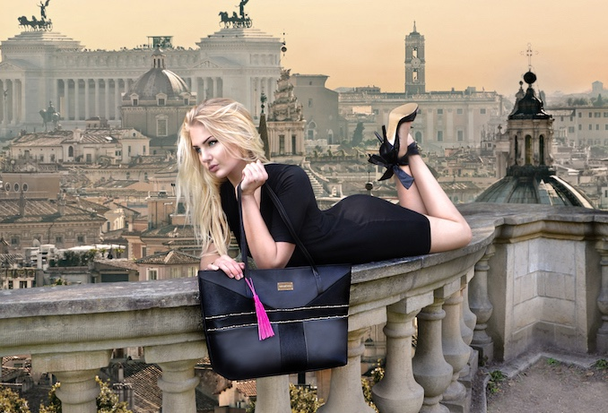 A finalized photo of Diana Von Gruning modeling one of her handbags atop a railing in Europe.