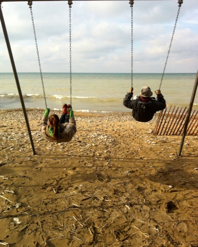 Kaitlyn Riordan - Kaitlyn and her mom swinging overlooking Lake Huron on Christmas Day, 2016