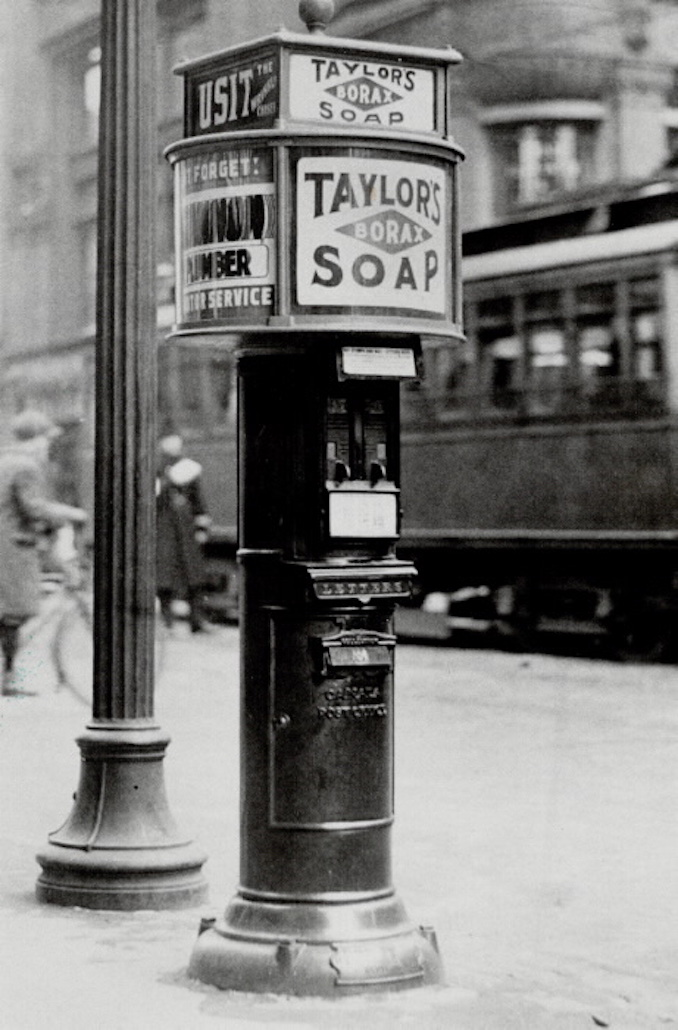 1916 - besides serving as letter drops; they also dispensed stamps and had miniature billboards on top. This photo; taken at Yonge and Richmond Sts. in 1916