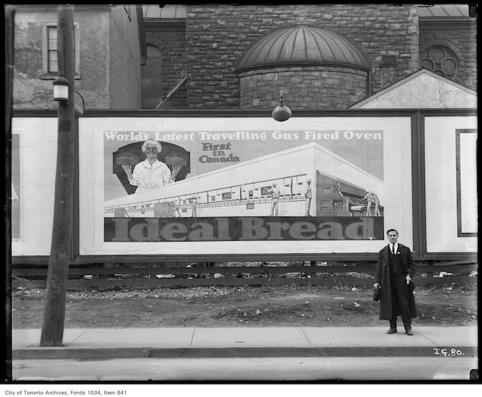1923 - Billboard advertising Ideal Bread showing artists conception of the first gas-fired traveling oven in Canada