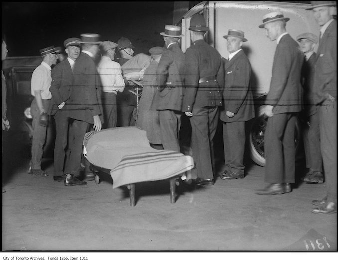 1923 - aug 19 - Wawa Hotel, putting injured in ambulance