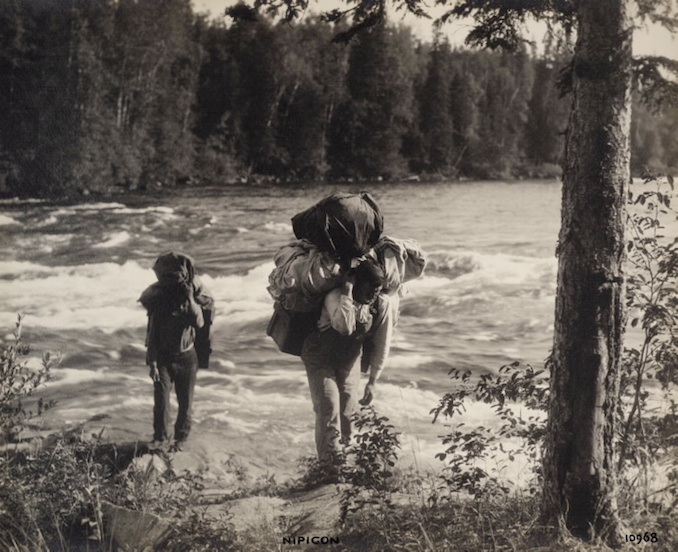 1925 - H. Armstrong Roberts - Nipigon Men carrying supplies