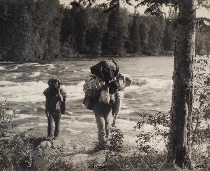 1925 - H. Armstrong Roberts - Nipigon Men carrying supplies
