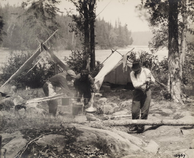 1925 - H. Armstrong Roberts - Nipigon Men cooking copy