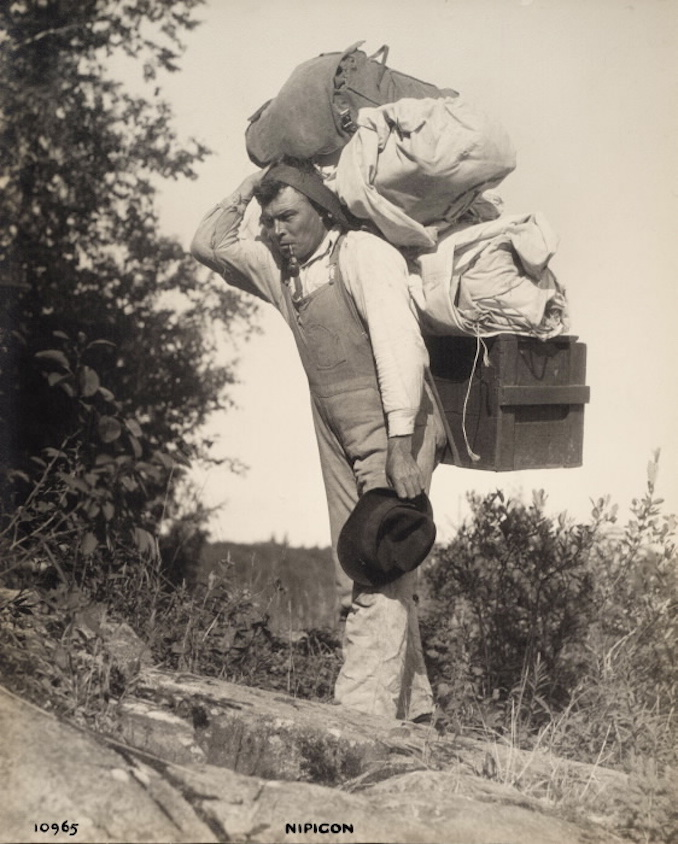 1925 - Nipigon - Men Carrying Supplies