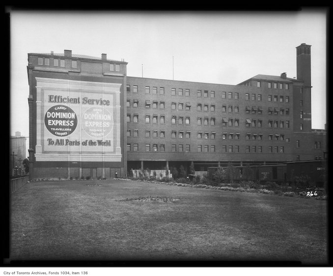 vintage advertising toronto - 1926 - Commercial building with Dominion Express Advertisement on wall