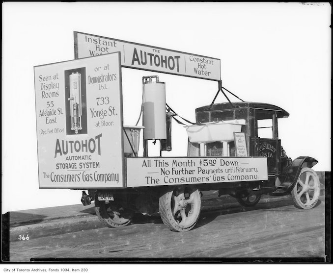 1926 - Ruud Autohot gas water heater and tank displayed on a truck