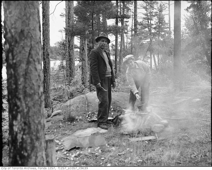 1930 - 1956 - Man and woman at campfire, French River Bungalow Camp