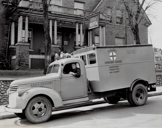 1946 - Kevin W Moore - city council was considering the purchase of an ambulance when Schram arrived to solve the problem. Using his army re-establishment credit and gratuities; he purchased this Red Cross ambulance.