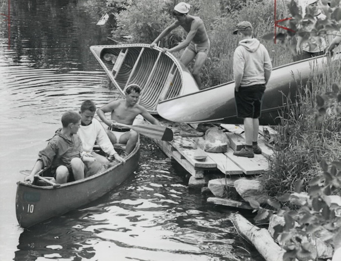 1967 - Ontario holiday - Boys' and girls' camps - Boys from a camp near Burks Falls make a portage at Magnetawan on their canoe trip in the Almaguin Highlands